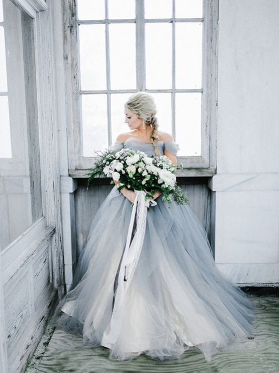 a trendy grey off the shoulder wedding ballgown with many layers is a more modern version of princess style dresses