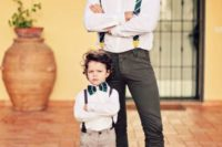 23 grey chinos, a white shirt,a  burgundy bow tie, striped green suspenders and grey suede loafers