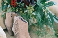 23 nude suede peep toe boho booties with long fringe on the sides look very wild and kinda cowboy style a bit