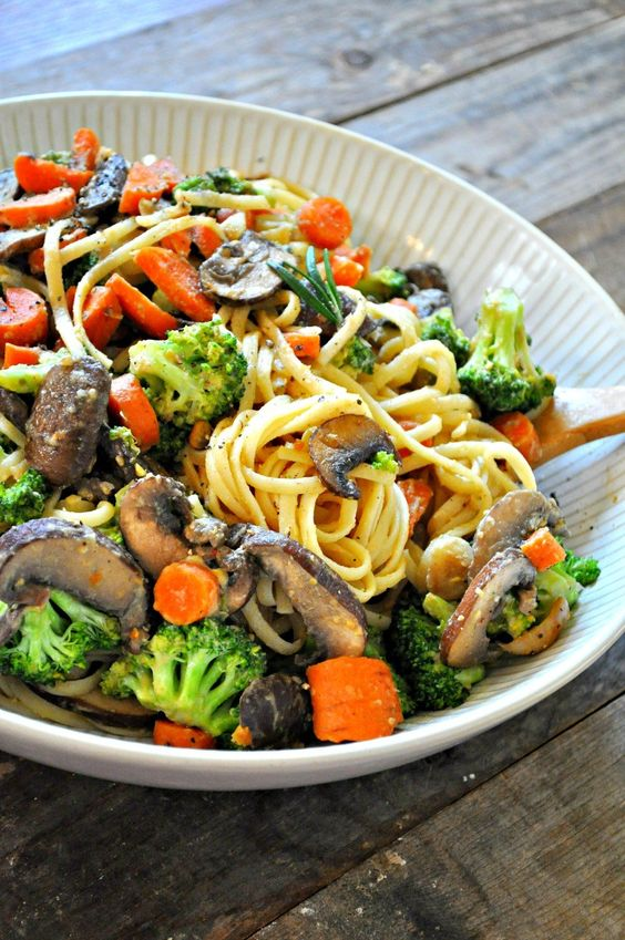 vegan creamy Dijon veggie pasta with small head broccoli, carrots, mushrooms