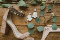 25 nude suede block heels with ankle straps embellished with rhinestones and pearls for a boho bride