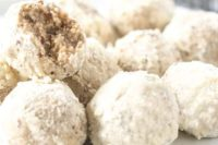 28 vegan gluten free Mexican wedding cookies are sugar-coated pecan balls with almond and vanilla