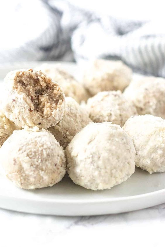 vegan gluten free Mexican wedding cookies are sugar coated pecan balls with almond and vanilla