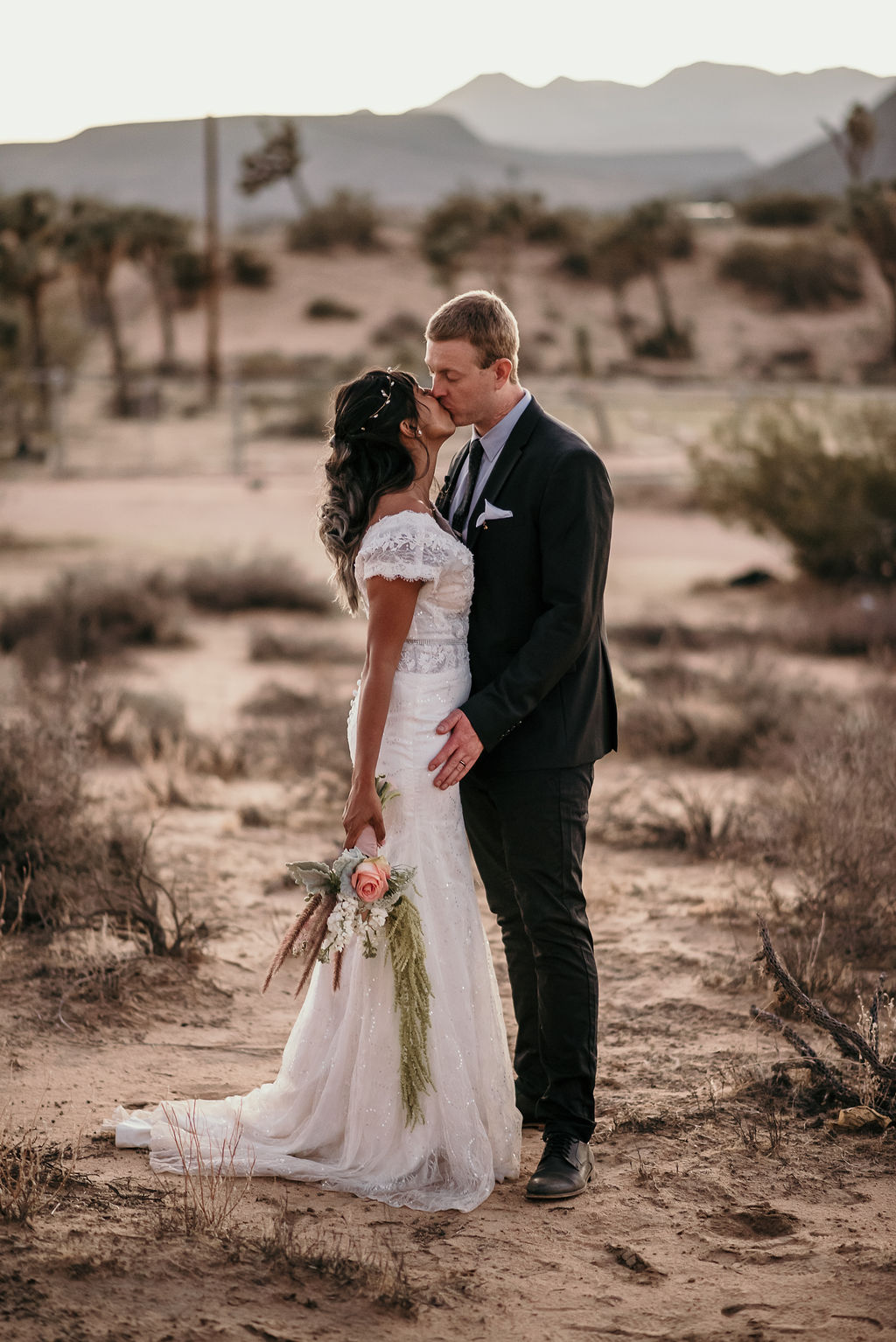 This couple went for a boho wedding in the desert with only some nearest people around