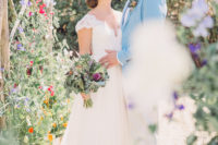 02 The bride was wearing a lace A-line wedding gown with a V-neckline, cap sleeves