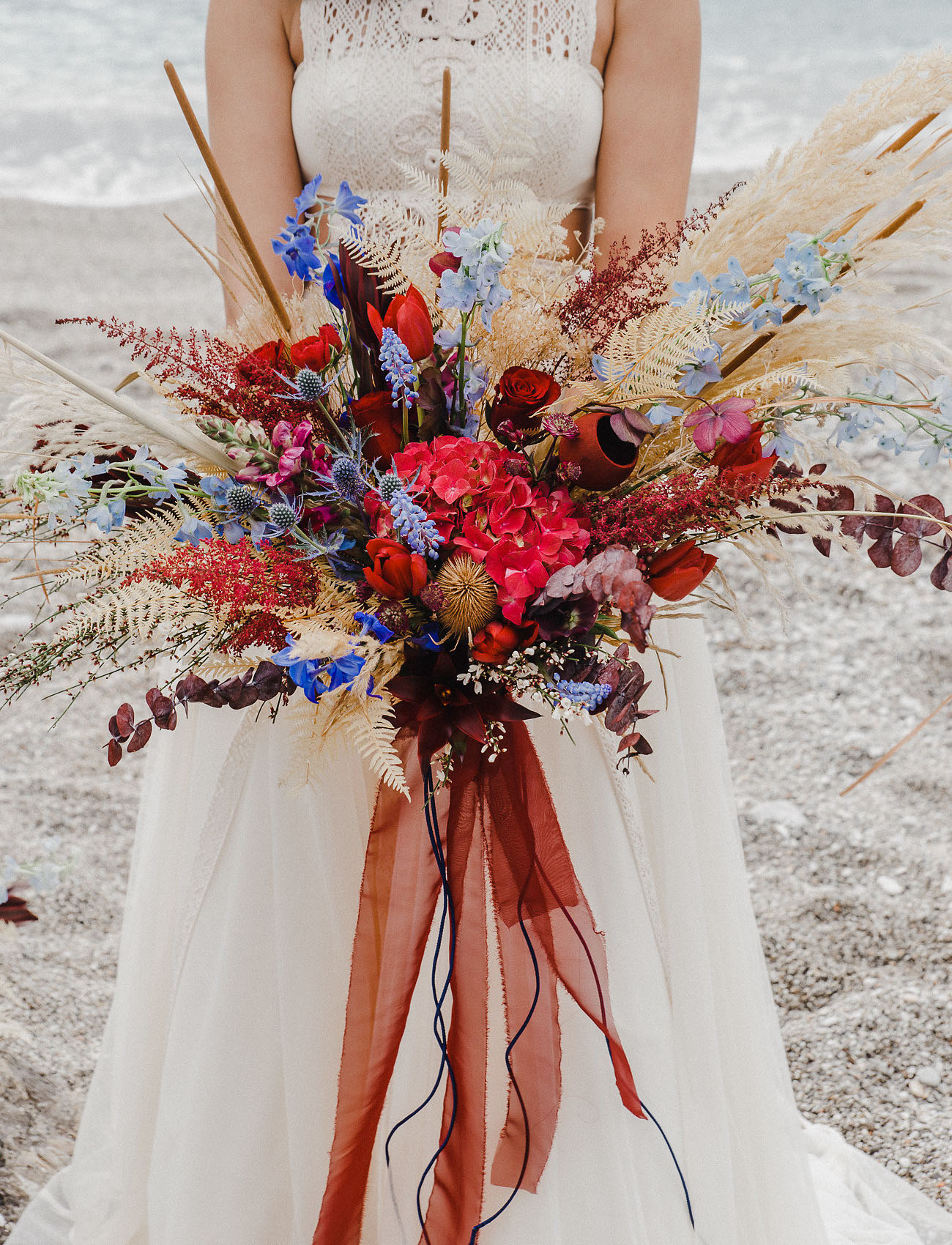 The wedding bouquet was super bright, red, blue, mustard, with lots of texture and ribbons