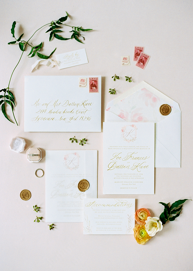 The wedding stationery suite is done in swete pastels and with gold calligraphy