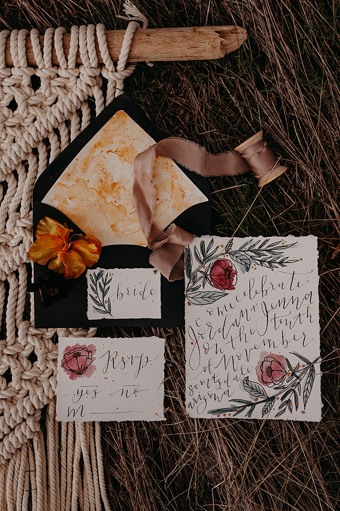 The wedding stationery was done with a raw edge, calligraphy and watercolors in bright shades