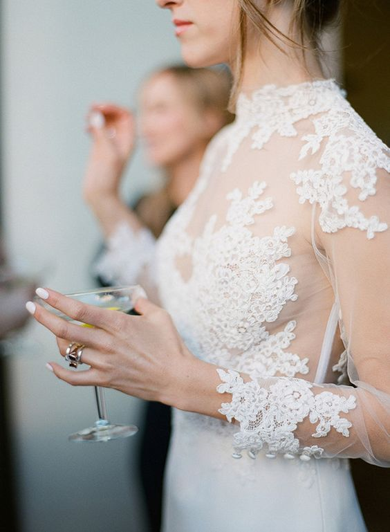 a modern wedding dress with an illusion lace bodice with a turtleneck and long sleeves plus a plain sheath skirt