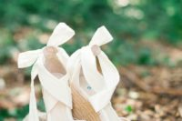 02 white peep toe wedding wedges with large bows and neutral wicker platforms for a rustic feel