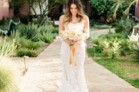 03 One bride was wearing a strapless floral applique mermaid wedding dress with a train