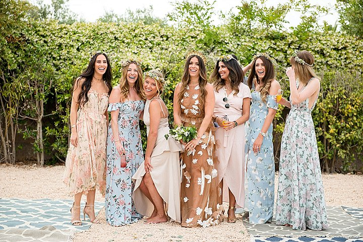 bridesmaids in floral and solid dresses