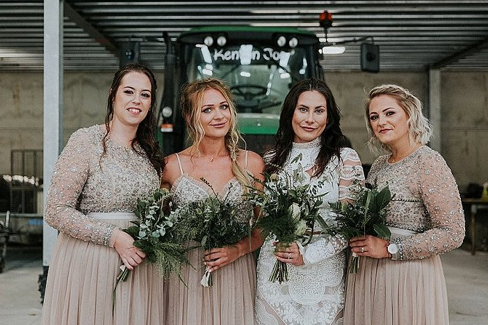 The bridesmaids were wearing mismatching nude embellished maxi dresses