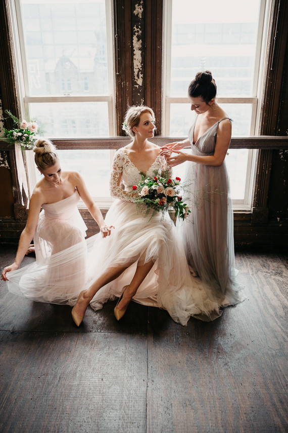 The bridesmaids were wearing powder blue and blush mismatching dresses and top knots to create ballet dancer-inspired looks