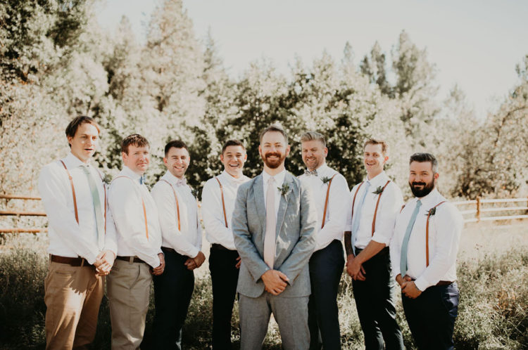The groom was wearing a light grey suit with a blush tie, and the groomsmen were wearing suspenders and mint ties