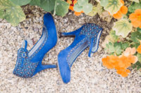 a pair of blue heels is an edgy choice for fashion-forward bride
