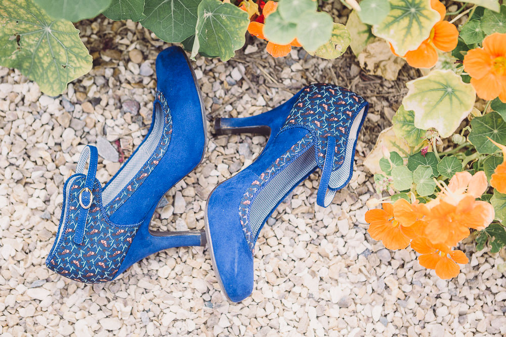 a pair of blue heels is an edgy choice for fashion forward bride