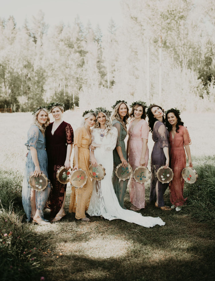 The bridesmaids were wearing mismatching maxi dresses and were holding tambourines with embroidery