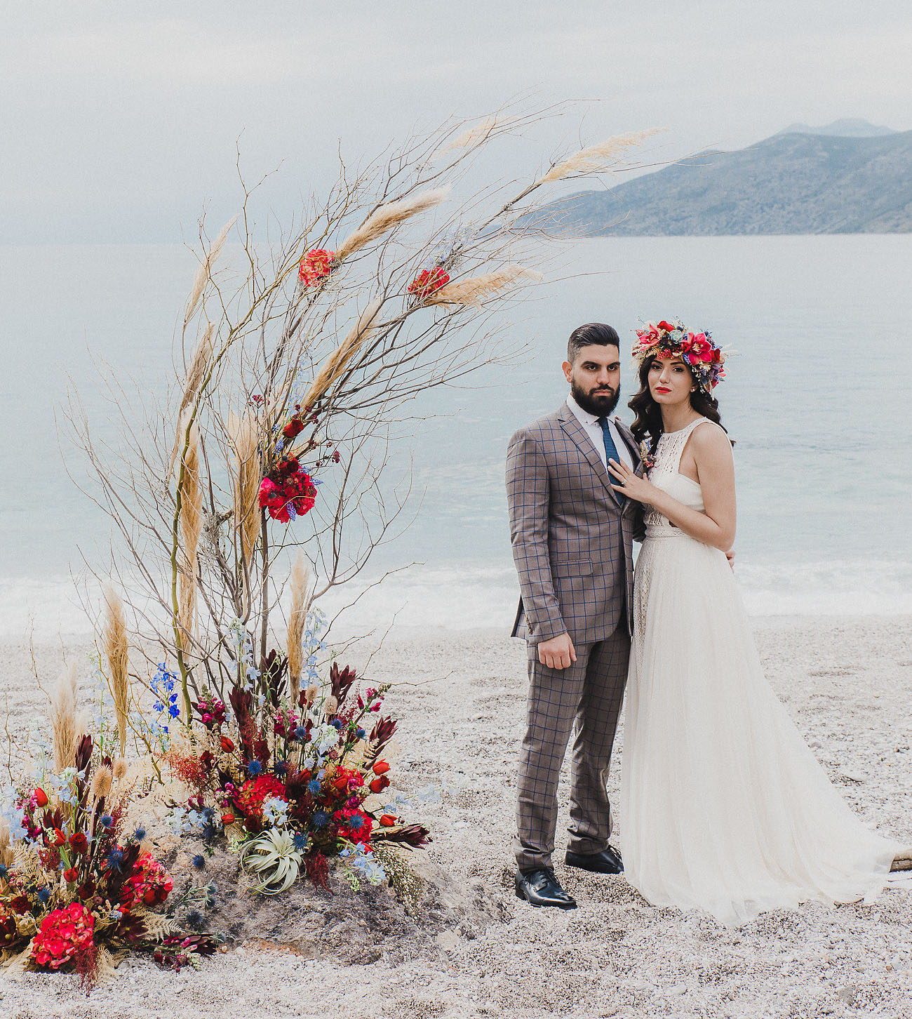 The groom was wearing a brown suit with a windowpane print and a blue tie