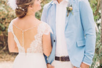 05 The groom was wearing neutral pants, a white shirt and a light blue blazer