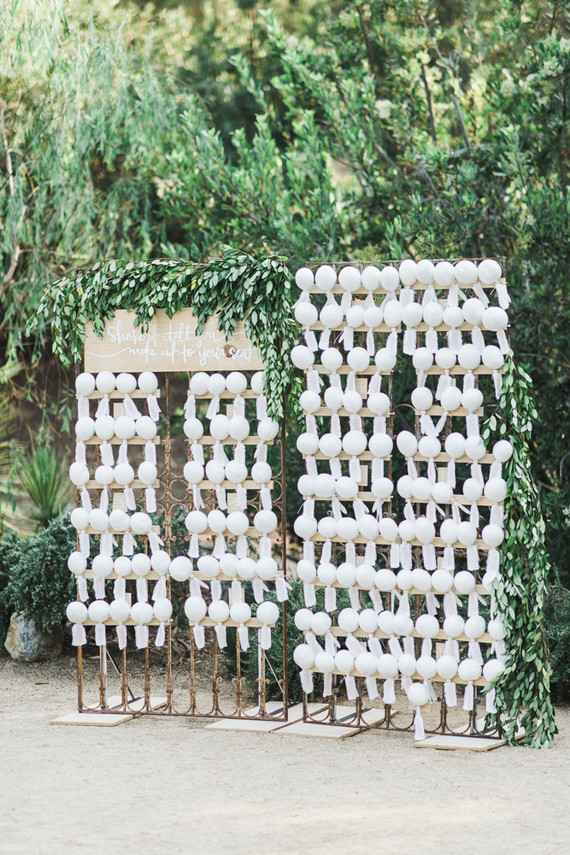 The seating chart was done with gates and maracas that served as wedding favors, too