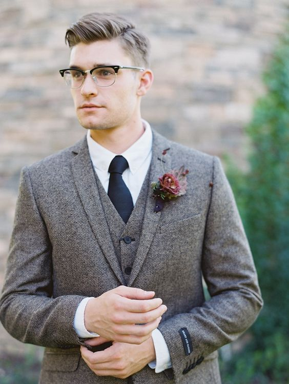 an elegant taper cut with trendy retro-inspired glasses create a chic vintage-inspired look