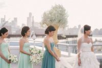 05 aqua-colored strapless maxi dresses with draped bodices and a green matching one for the maid of honor