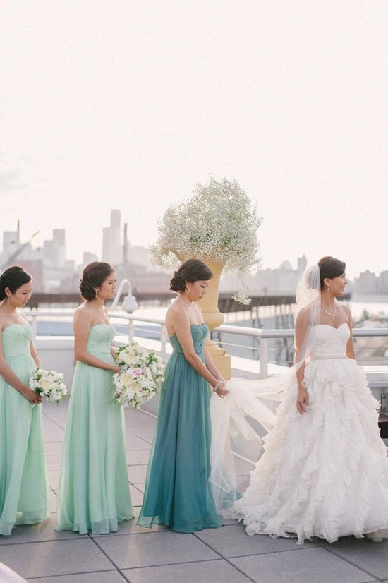 aqua-colored strapless maxi dresses with draped bodices and a green matching one for the maid of honor