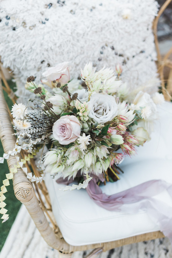 The wedding bouquet was done in neutrals and blush and lavender