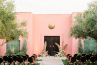 06 The wedding ceremony space was done in pink, black and gold and with black and gold chairs
