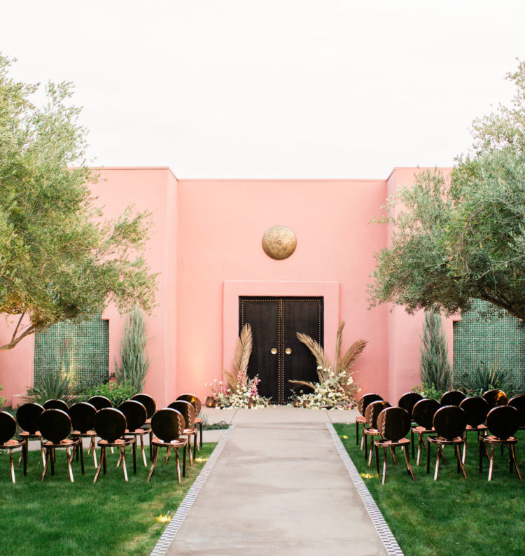 The wedding ceremony space was done in pink, black and gold and with black and gold chairs