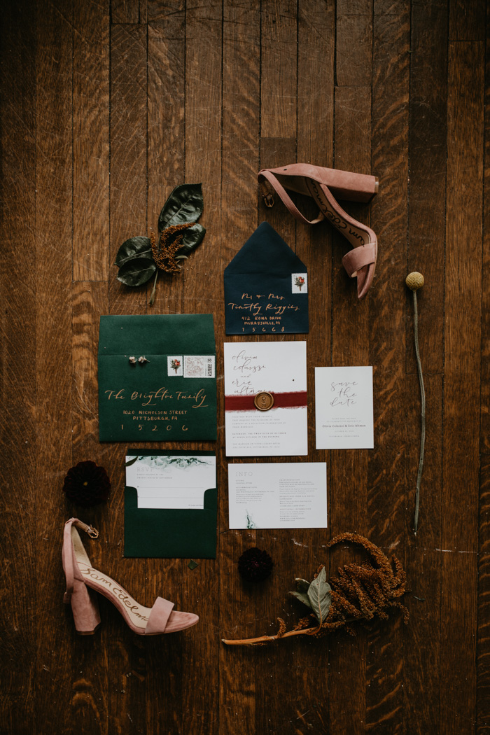The wedding stationery was done in teal, dark green and burgundy to match the season and colors