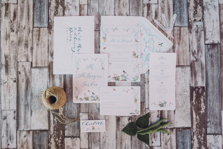 The wedding stationery was done with some painted blooms and watering cans