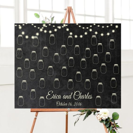 a chalkboard sign with drawn jars and lights is a cool idea and a fun artwork to use it after the wedding