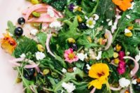 06 an ultimate spring salad of arugula, blueberries, baby kale, pistachios and edible nasturtium flowers