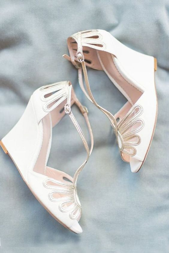 elegant laser cut wedding wedges with touches of silver and thin ankle straps for a vintage feel