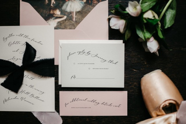 The wedding invitation suite was done in blush and white with black calligraphy