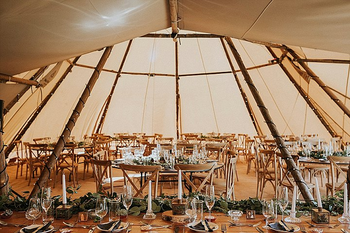 The wedding teepee was done with lots of foliage and candles - all this decor was created by the bride