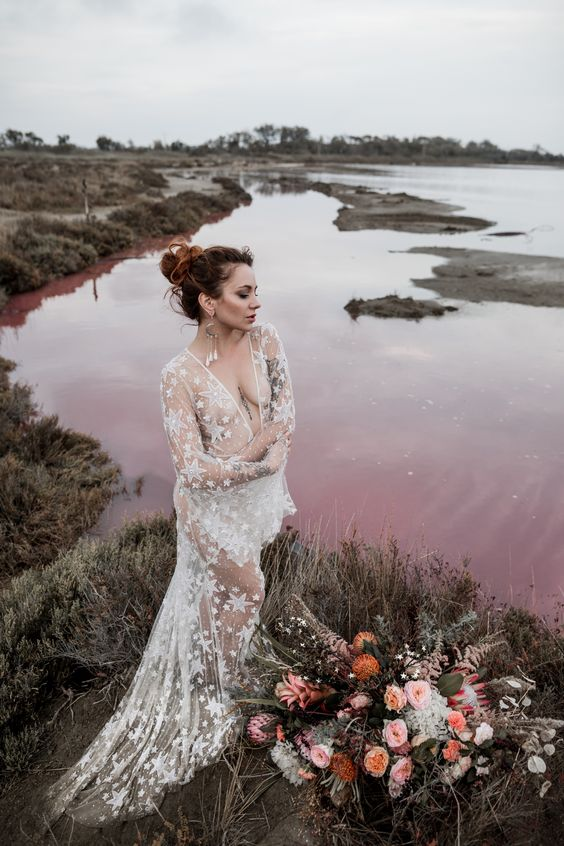 a celestial white sheer wedding dress with long sleeves and a train can be worn with some underwear or a bodysuit under