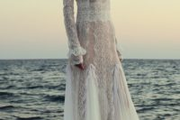 07 a chic free-spirited lace sheath wedding dress with long sleeves, a turtleneck and a catchy skirt with a train