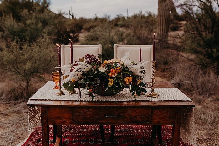 The centerpiece was a lush floral one, with bright orange, yellow and burgundy blooms and pampas grass