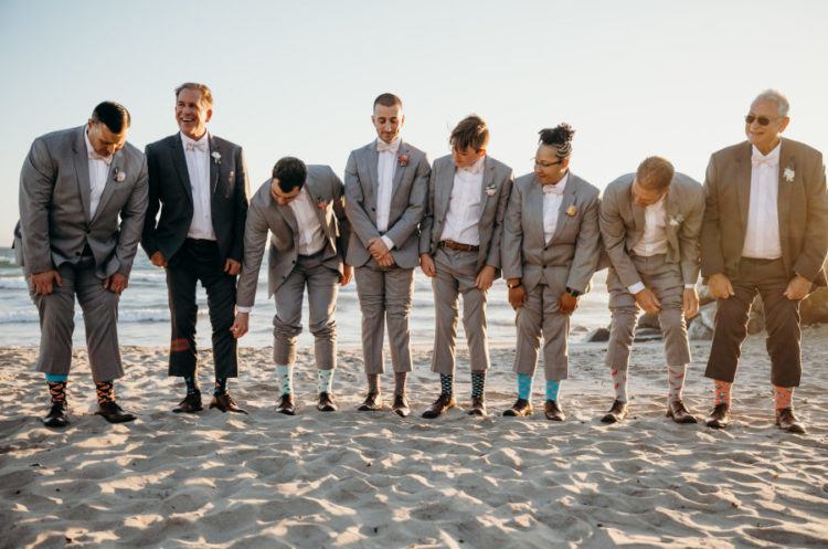 The groomsmen were wearing grey suits and blush bow ties