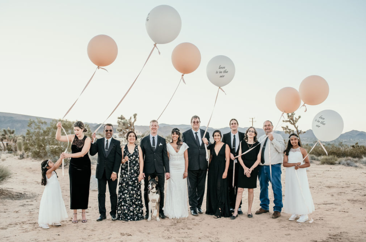 The guests were mostly wearing black and white to match the wedding color scheme