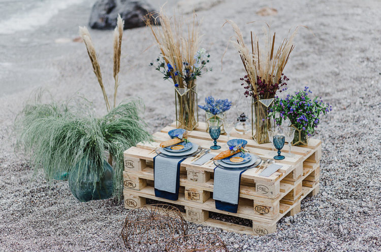 The wedding reception space was done with a pallet table and blues