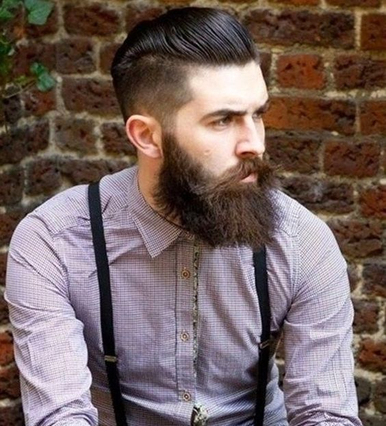a chic groom's pompadour with a large beard and moustache is a very hipster-like look