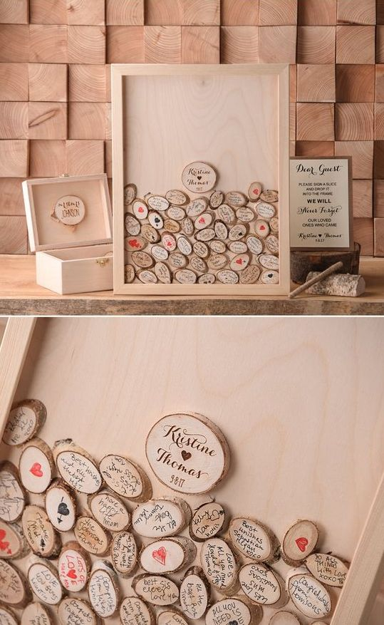 a wooden frame with small wood slices and an additional box with these slices is a stylish rustic guest book idea