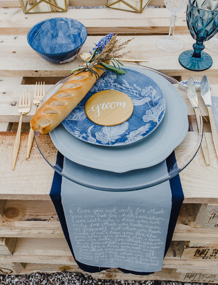 Blue glasses, plates, chargers, bowls, placemats and no tablecloth created a chic look