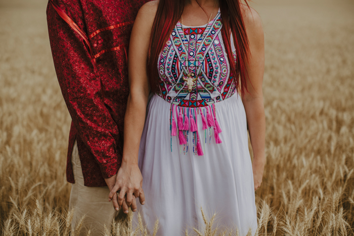 The bride was wearing a white maxi dress embellished and embroidered with traditional patterns and tassels and the groom was wearing traditional shirt