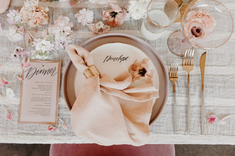 The table was all covered with blooms and petals and blush napkins added soft colors to the tablescape