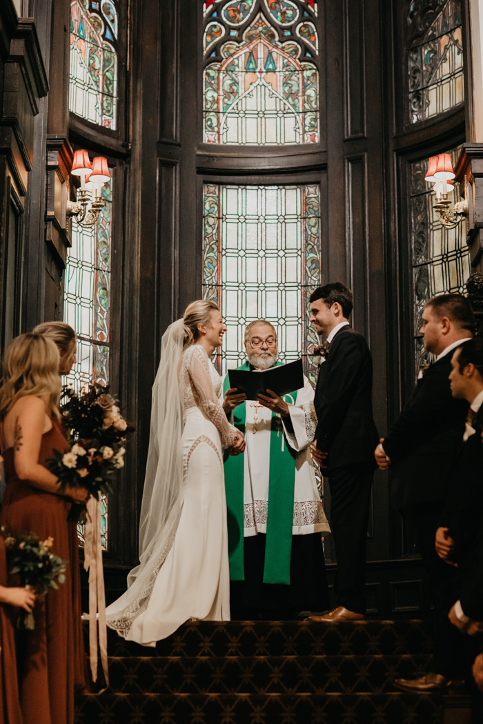 The wedding ceremony took place in a church, the officiant was the bride's uncle